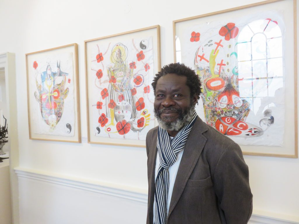 ernest-duku-in-front-of-his-work